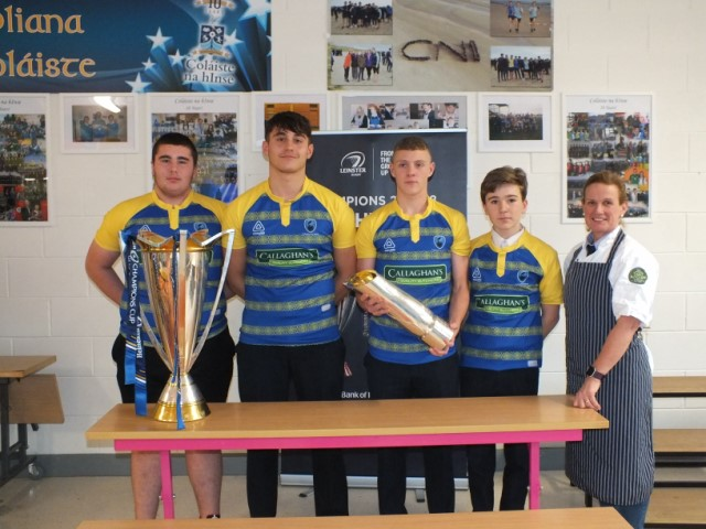 Rugby Players in their new jersey with the Champions Cup and Pro 14 trophies 640x480